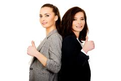 Two businesswomen with thumbs up. Stock Photo