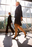 Two businesswomen with trolley Stock Images