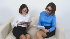 Two businesswomen using tablet computer and stock footage