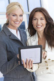 Two Businesswomen or Women Using Tablet Computer Royalty Free Stock Photos