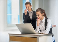 Two businesswomen work at the laptop Royalty Free Stock Photo