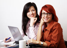 Two businesswomen are working Stock Photos
