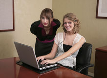 Two businesswomen working on a computer Royalty Free Stock Photos