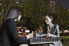Two Businesswomen Working While Having Dinner Royalty Free Stock Images