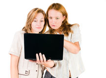 Two businesswomen working on laptop. Two young businesswomen working on laptop Stock Photography