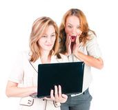 Two businesswomen working on laptop. Two young businesswomen working on laptop Stock Photo