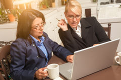 Two Businesswomen Working on Laptop Computer Royalty Free Stock Photo