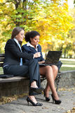 Two businesswomen working, outdoor Royalty Free Stock Photo