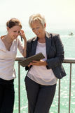 Two businesswomen working outside the office Stock Images