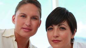 Two businesswomen working together stock video