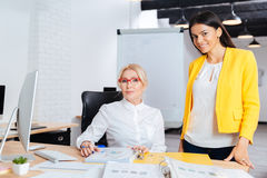 Two businesswomen working together on the computer at the table Stock Images