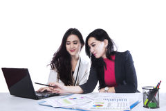 Two businesswomen working together 1 Stock Photo