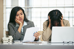 Two businesswomen worry about their bankruptcy Royalty Free Stock Image