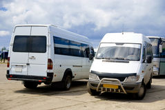 Two busses. Two white busses standing in station. Outdoor shot Stock Image