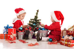 Two busy santa helpers Royalty Free Stock Photos