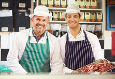 Two Butchers At Work In Shop Stock Image