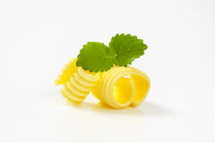 Two butter curls. Curls of fresh butter on white background royalty free stock images