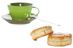 Two buttery scones and tea cup Stock Image