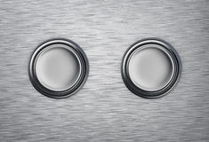 Two buttons on a metal background Royalty Free Stock Photo