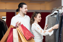 Two buyers with shopping bags  at clothing shop Royalty Free Stock Photos