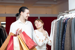 Two buyers with shopping bags  at clothing shop. Two happy buyers with shopping bags  at clothing shop Royalty Free Stock Photos