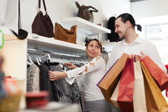 Two buyers with shopping bags  at clothing shop Stock Images