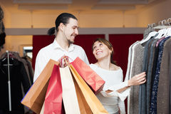 Two buyers with shopping bags  at  shop. Two adult buyers with shopping bags  at clothing shop Royalty Free Stock Photo