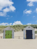 Two Cabins or Huts on the Beach Royalty Free Stock Photography