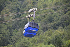 Two cabins. Two ropeway cabins lifting in summer next to each other Royalty Free Stock Images