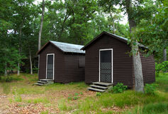 Two cabins in the woods Stock Photo