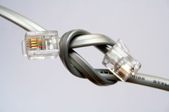 Two cables for data transmission with tips knotted Stock Photography