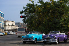 Two cabriolet classic cars parked on the mainstreet in Havana Cuba Royalty Free Stock Images