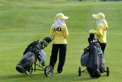 Two Caddies At A Golf Course Royalty Free Stock Photography