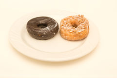 Two Cake Donuts on White Plate Royalty Free Stock Photography