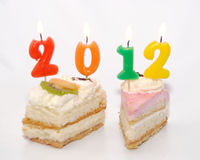 Two cakes with 2012 in candles. Two cakes with candles forming the year 2012, on a white background Stock Image