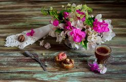 Two cakes, a bouquet of flowers and a cup of coffee Royalty Free Stock Image