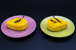 Two cakes on green and purple plates dessert food. Two sweet cakes on green and purple plates food Stock Images