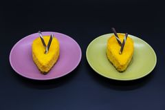 Two cakes on green and purple plates dessert food. Two sweet cakes on green and purple plates food Royalty Free Stock Photography