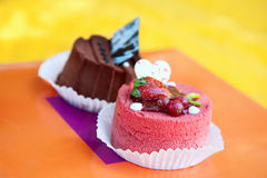 Two cakes with strawberry and chocolate Stock Photos