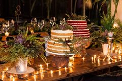 Two cakes for the wedding celebration in the night. Two different cakes in a nocturnal atmosphere decorated for a wedding party royalty free stock photos
