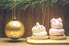 Two cakes on wooden background with fir with golden ball. Christmas toy and two cakes Royalty Free Stock Photography