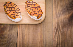 Two cakes on a wooden table Royalty Free Stock Image