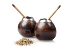 Two calabashes with yerba mate isolated on white Royalty Free Stock Images