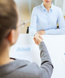 Two calm businesswoman shaking hands in office Royalty Free Stock Photo
