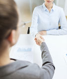 Two calm businesswoman shaking hands in office Stock Photography