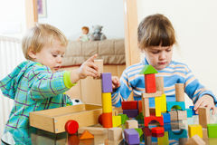 Two calm children playing in home Stock Photo