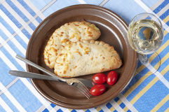 Two calzone bread and white wine Royalty Free Stock Photo