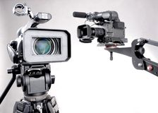 Two camcorders. Stand high-definition camcorder and unfocused dv-cam camcorder on crane Royalty Free Stock Photo