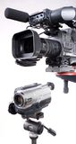 Two cameras. Dv-cam camcorder and home video camera with white background Royalty Free Stock Photos
