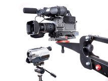 Two cameras. Dv-cam camcorder and home video camera with white background Stock Photography